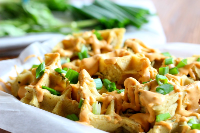 Thai Basil Waffle Nachos with Sriracha Peanut Sauce {Gluten Free, Dairy Free}. Make these waffle nachos for a tasty breakfast or share it as a snack! TheFitFoodieMama.com