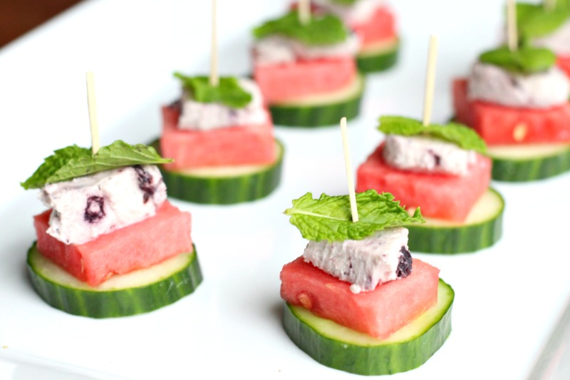 Easy Summertime Watermelon, Cucumber, Blueberry Goat Cheese & Mint Bites.  Perfect and simple for a healthy summer appetizer for a party, picnic or barbecue.  Find the recipe on TheFitFoodieMama.com