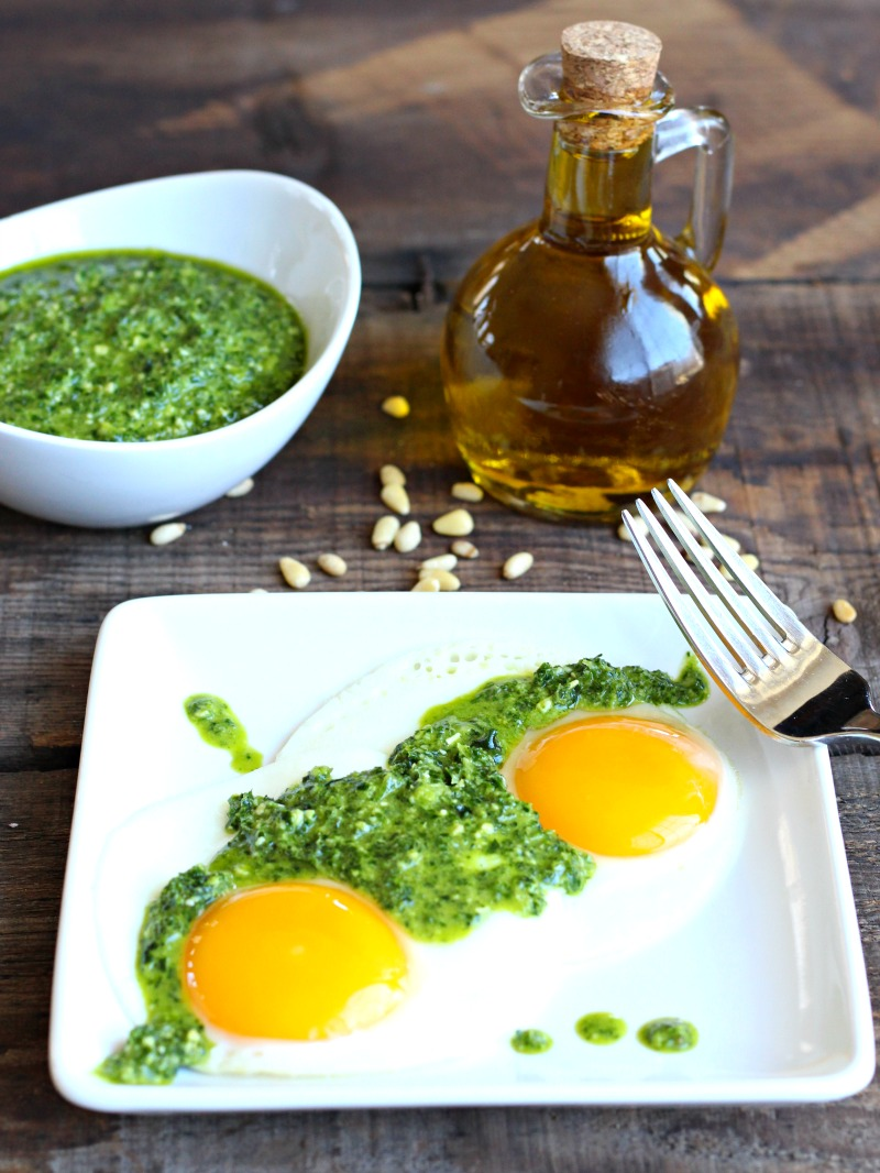 Craving Green Eggs? Try this dairy free and gluten free Kale & Pine Nut Pesto Eggs! Festive and healthy- dye free and easy to make!