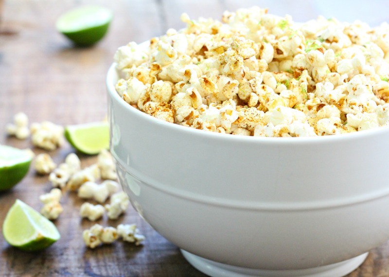 Easy, healthy and gluten free Honey Lime Chili Popcorn! Find the recipe on TheFitFoodieMama.com