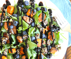 Refuel after your run with this Sweet Potato and Blueberry Superfood Salad. Perfect for lunch or dinner. Packed with honey glazed sweet potatoes, fresh fruit, baby kale and bit of chocolate pumpkin seed bars, it's the perfect recipe to help refuel and restore after a hard workout.