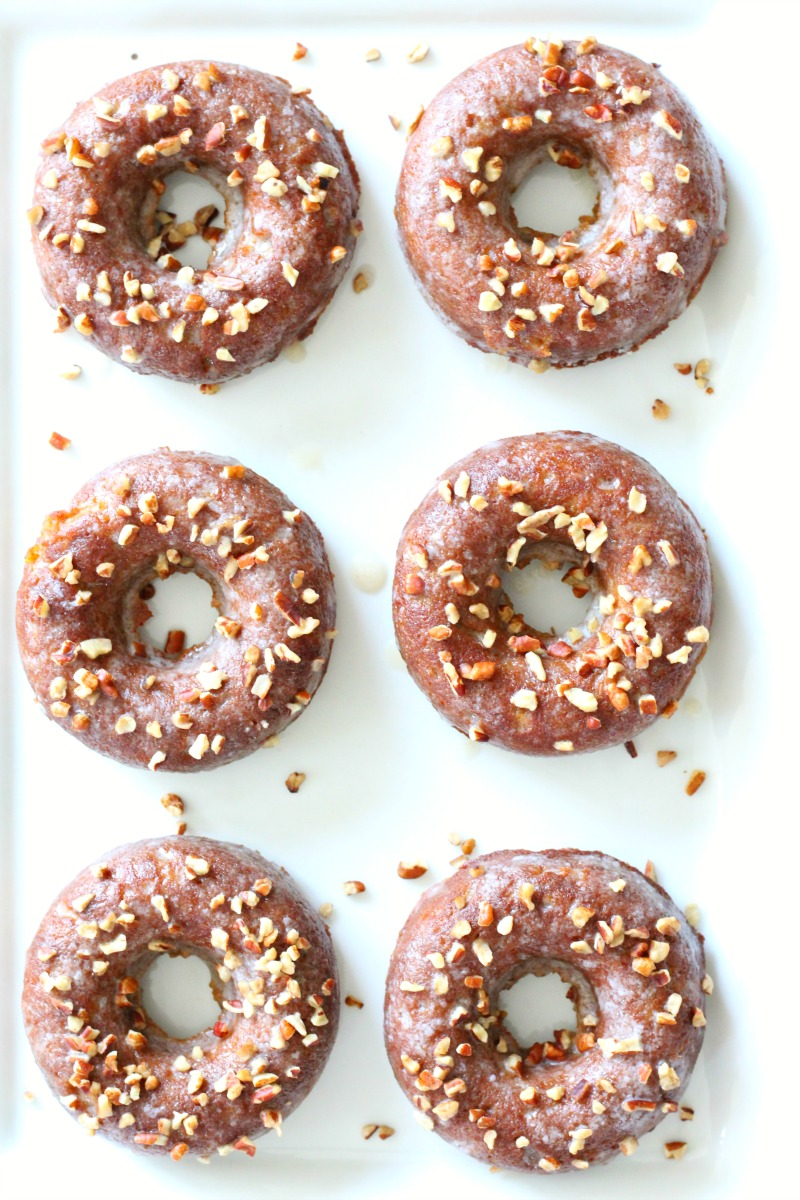 Quick and Easy Maple Pecan Paleo Donut Recipe. These donuts are high in plant protein making them the perfect post run or workout snack. Whip these up in less than 30 minutes for a healthy grab and go option during the week.